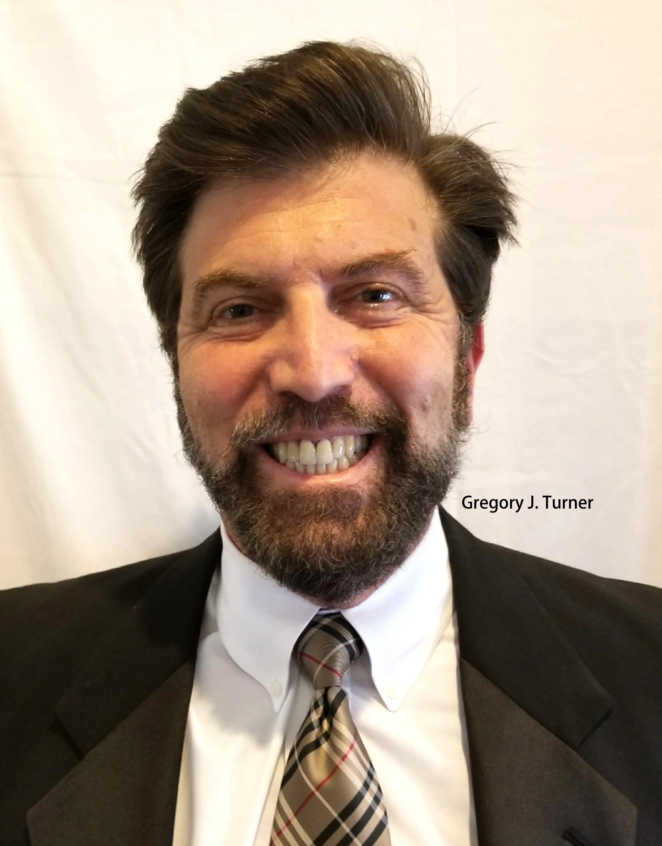 Gregory J. Turner 1